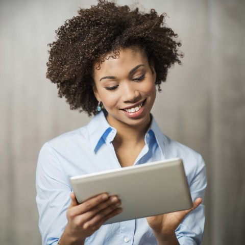 Woman learning a language with Premium PLUS on a tablet