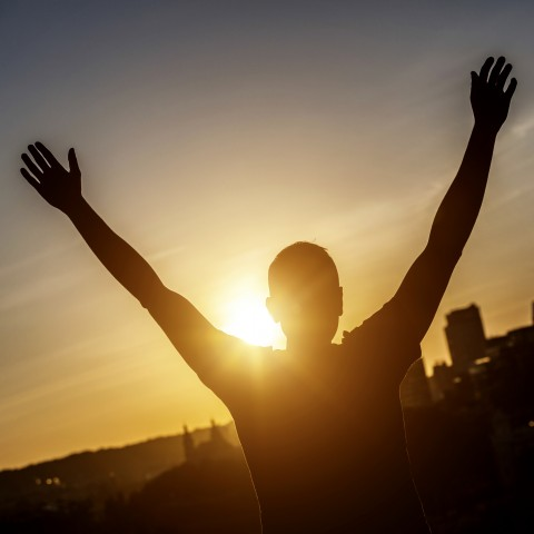 Person Stretching Out Arms to Sun