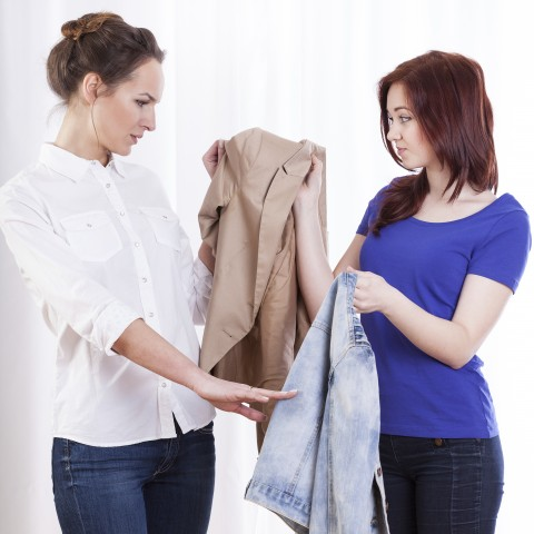Two Women Examining Clothes