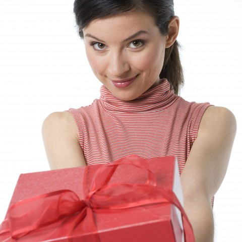 Woman Holding Out a Gift
