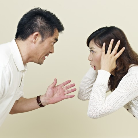 Asian Couple Fighting Head-to-Head, Woman Blocking Her Ears