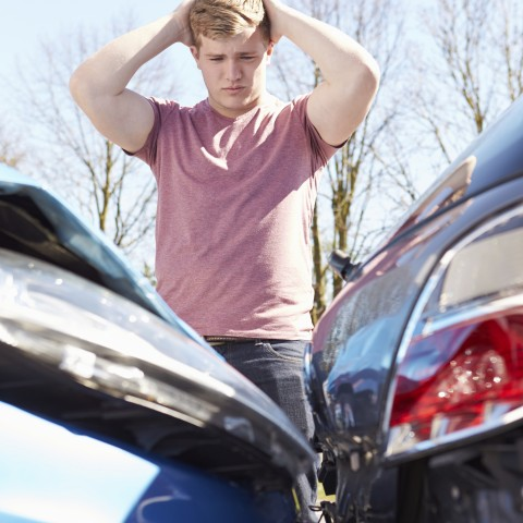Distraught Man Looking at Car