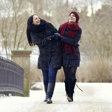 Women Walking Together in Snow