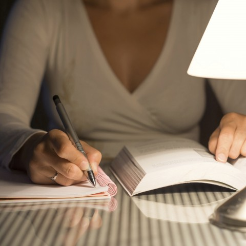 Woman Learning to Write in a New Language