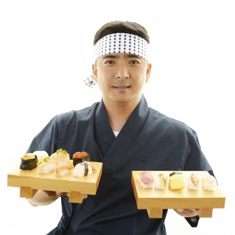 Man Holding Sushi Trays in Each Hand