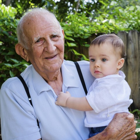 Grandfather Holding a Baby Grandson