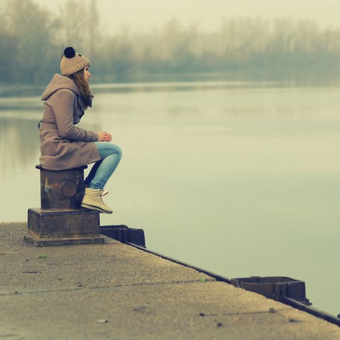 Woman Sitting Alone