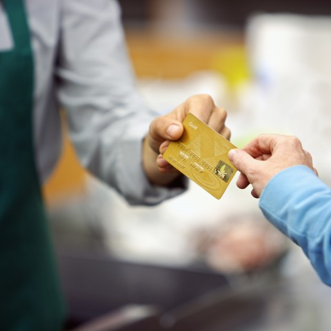 Man Giving Credit Card to a Clerk