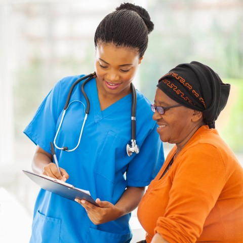 Nurse Speaking with Patient