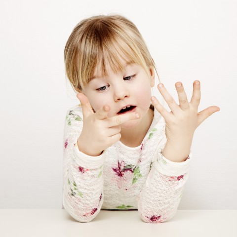 A Girl Counting With Her Fingers