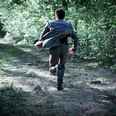 Man Running Away from Someone or Something