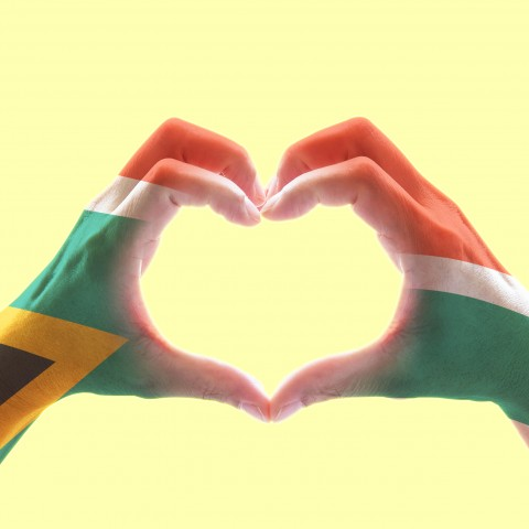 Two Hands Forming a Heart. The Hands are Painted with the South African Flag
