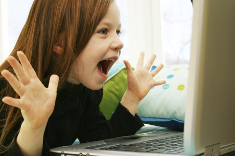 Girl Playing a Computer Game