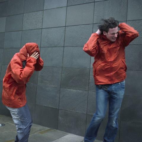 Two People in Heavy Wind