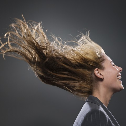 Laughing Woman with Closed Eyes and Hair Blown by the Wnd