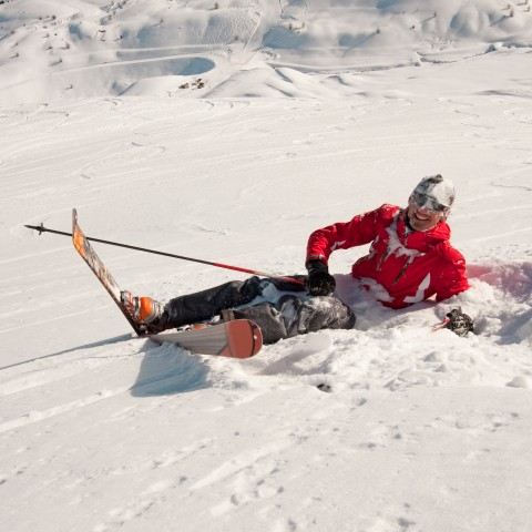 Skier Sitting in the Snow