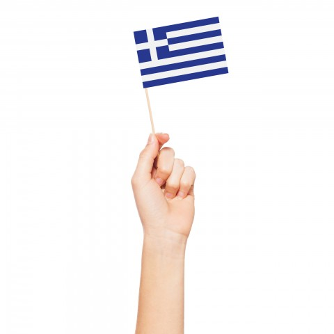 A Hand Holding a Small Greek Flag