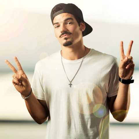 Young Rapper Showing the Victory Sign (also Called Peace Sign) with Both Hands