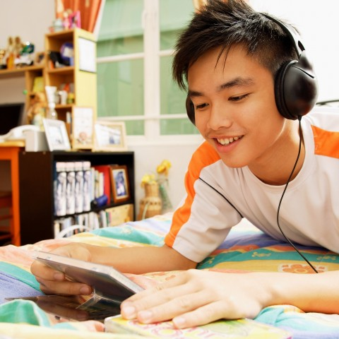 Boy Learning with Earphones