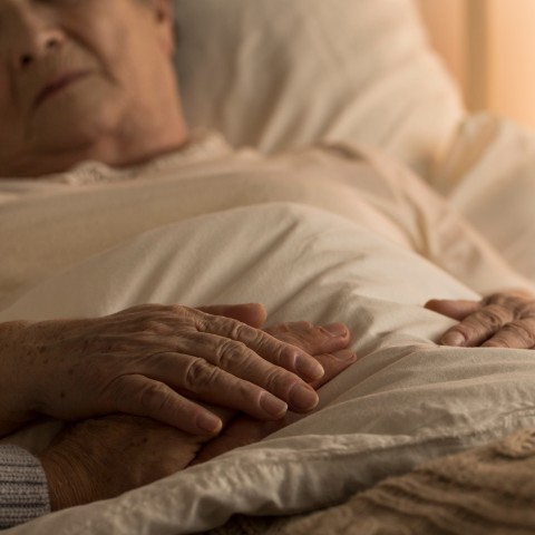 Elderly Person Lying in Bed
