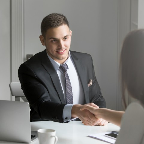 A Businessman Giving a Handshake During a Business Meeting