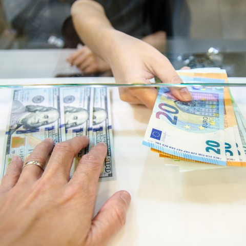 People Handling Paper Currency