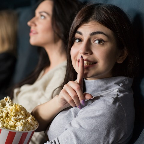 QUIET WOMAN IN MOVIE THEATER