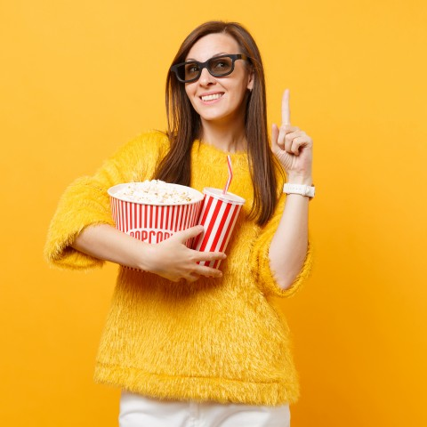 Woman with 3-D Glasses On, Standing with a Bowl of Popcorn