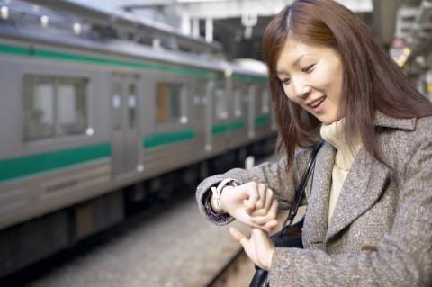 WOMAN AT STATION LOOKING AT WATCH