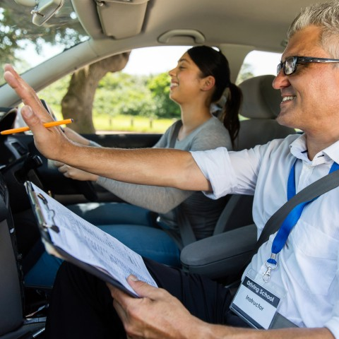 Woman in Car with Driving Instructor