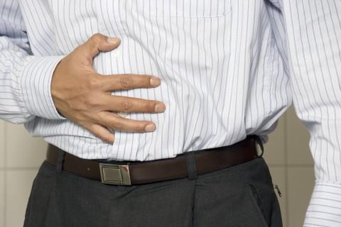 Man Clutching Stomach
