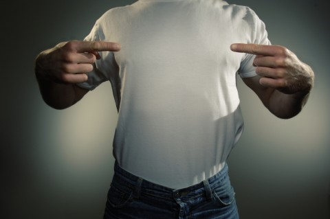Man in White T-shirt Pointing to His Torso