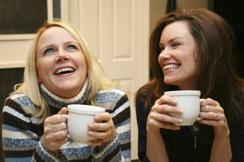 Two Women Chatting with Hot Drinks