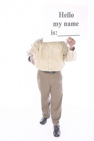 "Man Holding Up ""Hello My Name is"" Sign"