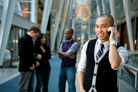 A Young Man Talking on His Cell Phone in a Street.
