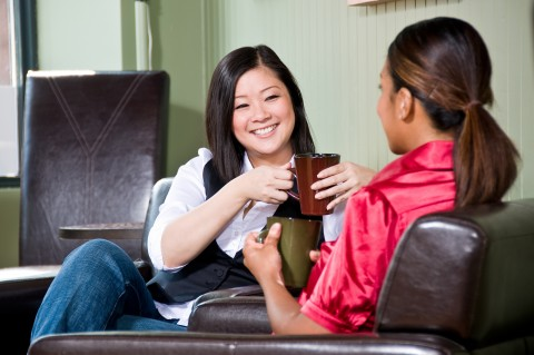 Asian and Black Woman Chatting with Coffee