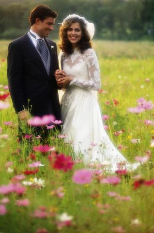 Bride and Groom in Field of Flowers