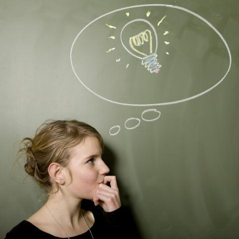 Woman with Chalk Drawing of Light Bulb Above head