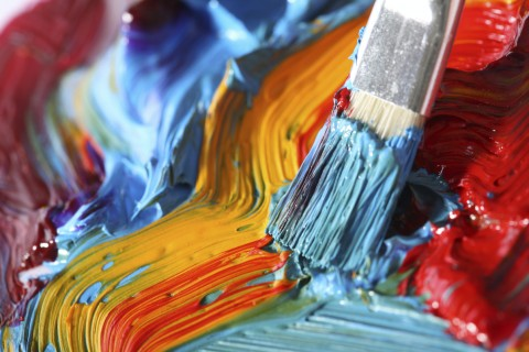 A Paint Brush and Different Colored Paints