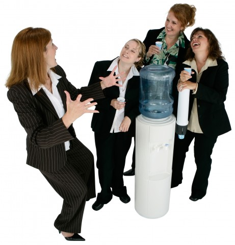 Women in Suits Talking Around a Water Cooler