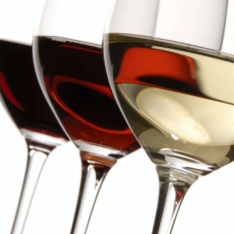 Three Different Glasses of Red And White Wine