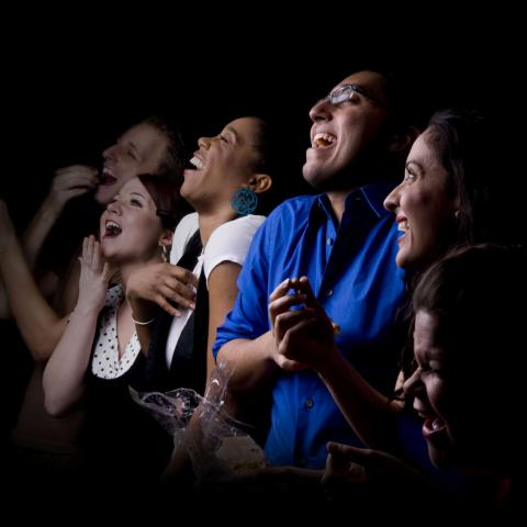 People Laughing in a Theater