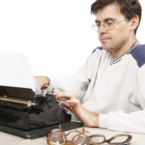 Journalist at Work with Typewriter