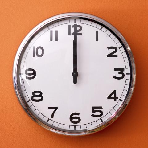 Clock Pointing to Midnight