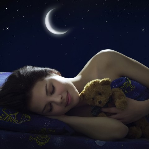 Girl sleeping; moon and starry sky