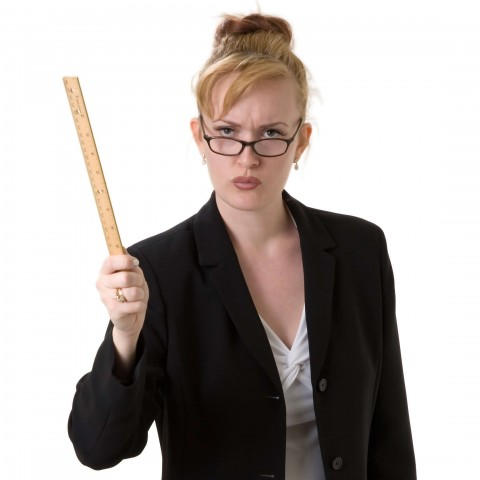 Angry School Mistress Shaking a Ruler As If Reprimanding