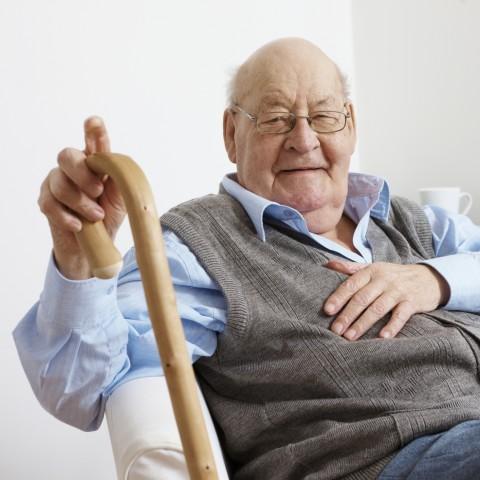 An Elderly Man Holding a Cane