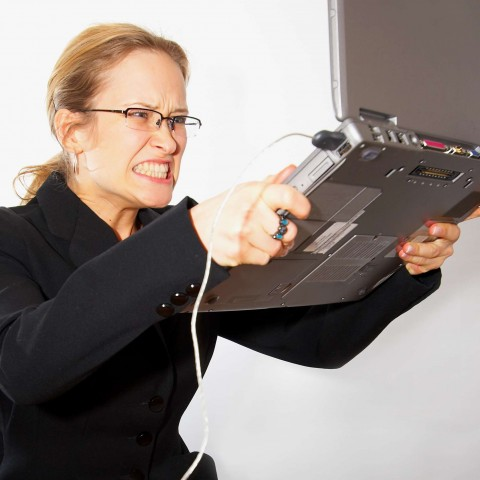 Angry Woman About to Throw Laptop