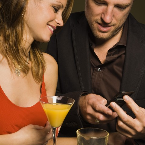 Man and Woman Exchanging Numbers on Date